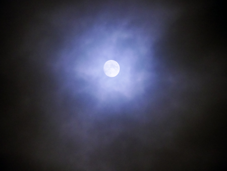 Moon and clouds in the fogy night photo