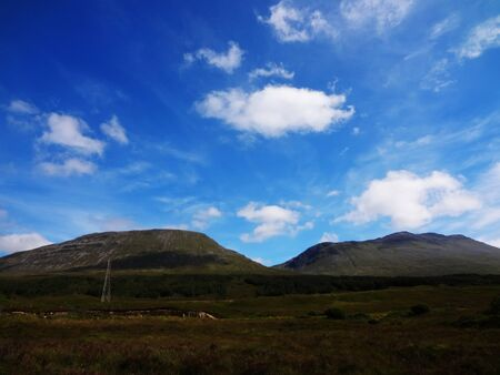 highlands: Scottish Highlands two mountains with blue sky