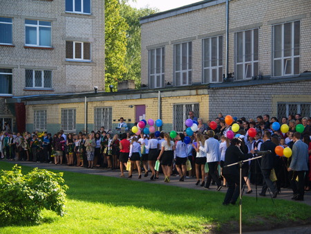 first day: Children with flowers in front of the School No. 68 on the first day of school on September 1, 2014 in Riga, Latvia. Editorial