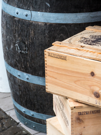Old Wooden barrel with few boxes on a side photo