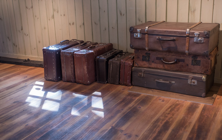 antique suitcase: old Vintage Suitcase in the room with wooden floor Stock Photo