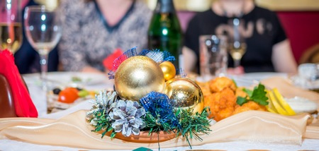 traditionally: Traditionally decorated christmas table, colorful decoration for celebration