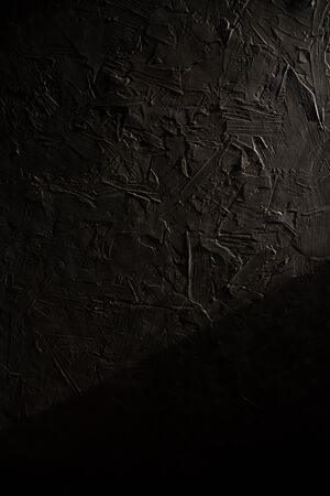 Black background made of natural cement or stone with a pronounced texture. This is a conceptual or metaphorical wall banner, grunge, material, aged. 版權商用圖片