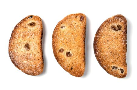 Sweet rusks with raisins sprinkled with sugar on a white background. Isolated image, a concept for your design.