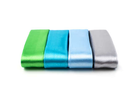 Set of satin ribbons on a white background. Side view. The concept of sewing accessories. Stockfoto