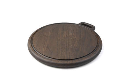 Wooden round cutting Board made of oak material, painted in a dark brown color, isolated on a white background. The concept of cooking.