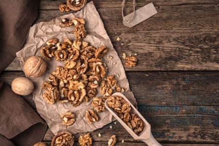 Peeled and shelled nuts on a wooden background. Top view with space to copy. The concept of useful products.