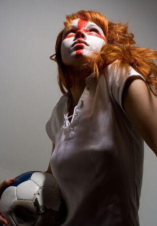 vigorously: english football makeup girl holding worn soccer ball