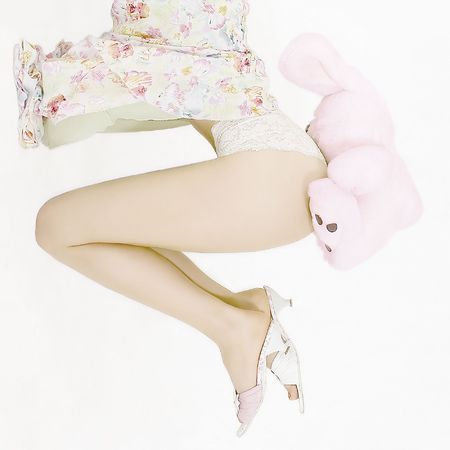 Woman legs and plush rabbit Stock Photo - 393257