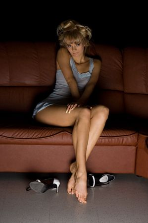 female in blue lingerie sitting on the sofa and watching tv