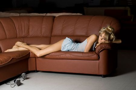 lonely girl in blue lingerie on the sofa Stock Photo - 401591