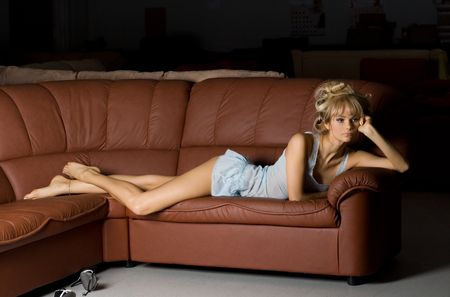 lonely girl in blue lingerie on the sofa Stock Photo - 401589