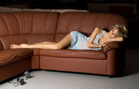 beautiful girl in blue lingerie sleeping on the sofa Stock Photo - 401592