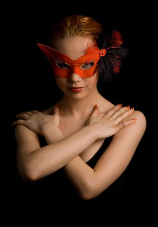 mysterious lady in red mask holding her arms in w shape Stock Photo - 401580