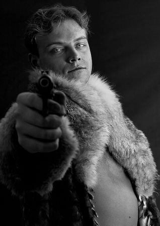 impassive: man with a gun Stock Photo