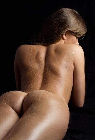 tanned naked girl in waterdrops Stock Photo - 411145