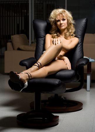 girl in black chair Stock Photo - 411143
