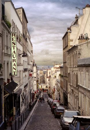 old-fashioned shot of narrow street of monmartre in paris, france photo