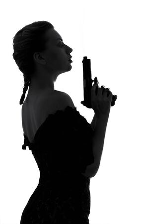 silhouette image of pretty girl with smoking gun Stock Photo - 423234