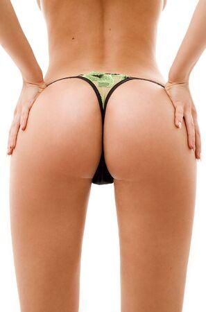 backshot of fit tanned girl in green underwear
