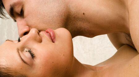 couple gently kissing Stock Photo