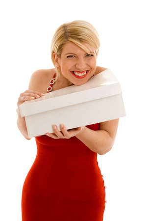 happy thankful girl in red dress holding white box Stock Photo - 439996