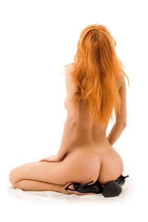 classical pin-up picture of naked redhead in black shoes photo