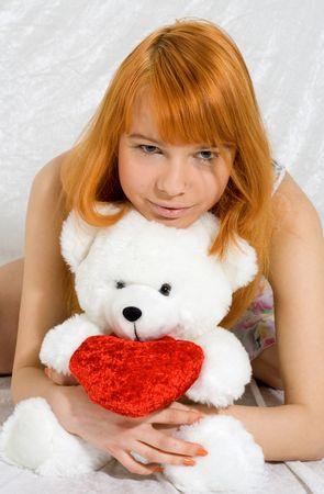 happy girl with teddy bear photo