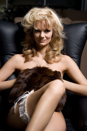 smiling naked blond in garter and muff Stock Photo - 453635