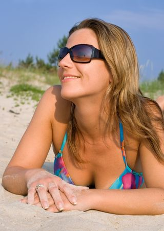 pretty girl relaxing on the beach photo