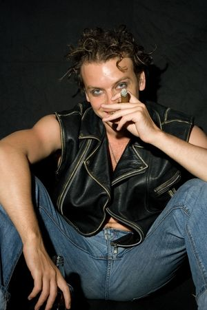 wet jeans: punk rocker smiking cigar and laughing