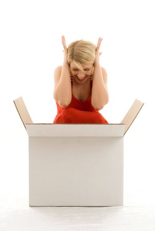 happy girl in red dress with big white box photo