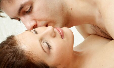 couple kissing in bed Stock Photo - 476322