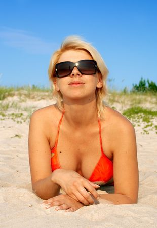 blond in orange bikini photo