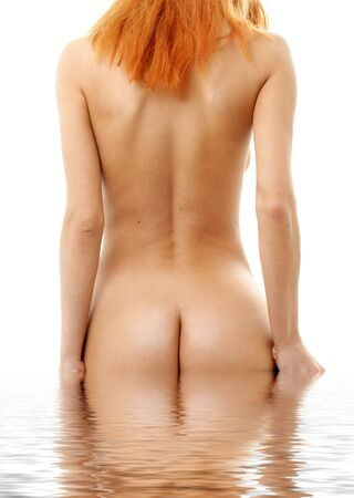 Backshot of pretty redhead in water Stock Photo - 486612