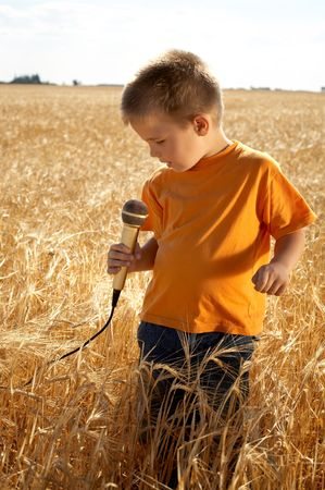 little singer at the field photo