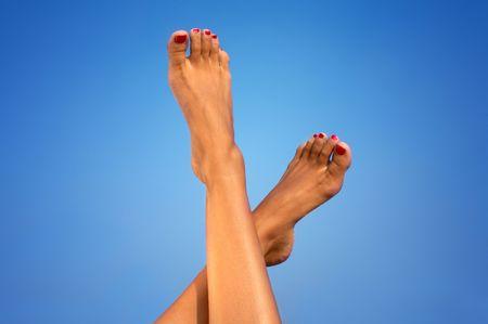 female legs over blue background Stock Photo - 495568