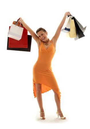 gl�ckliches M�dchen mit Einkaufenbeuteln Lizenzfreie Bilder