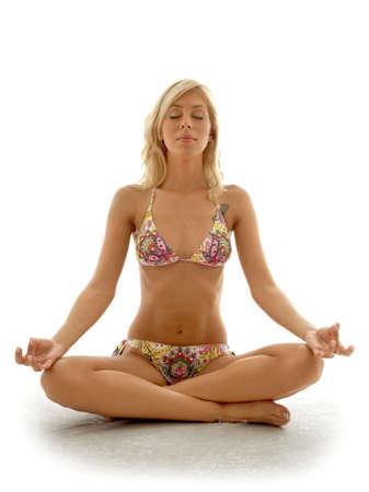 lovely blond in bikini meditating Stock Photo - 501568