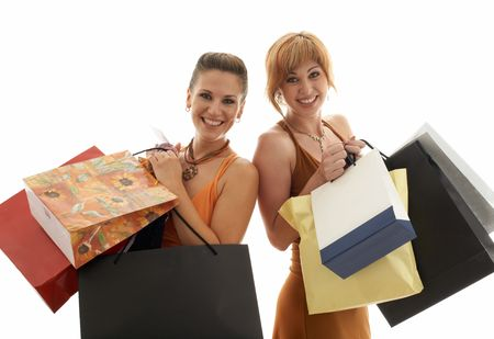 two happy girls with shopping bags photo