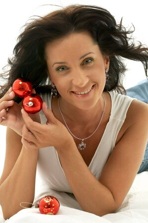 happy girl with christmas tree balls smiling photo