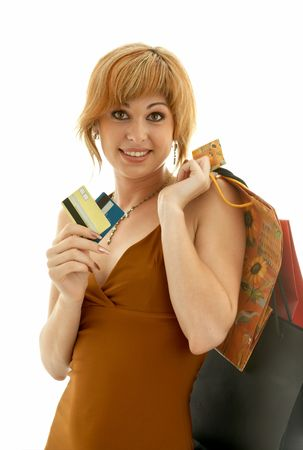 christmas debt: pretty girl with credit cards and shopping bags Stock Photo
