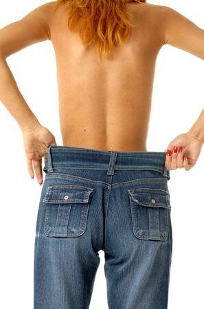 Slim girl in big size jeans Stock Photo - 509254