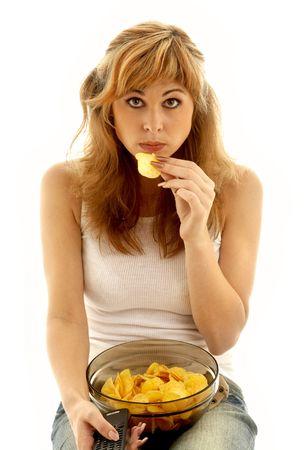 lovely girl eating potato chips Stock Photo