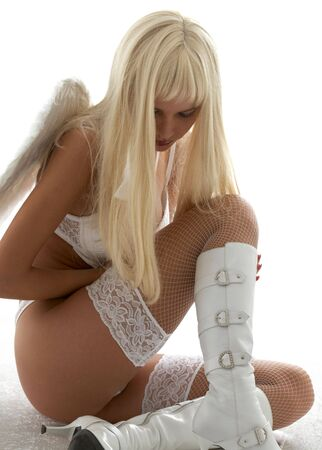 sad girl in white lingerie with angel wings photo