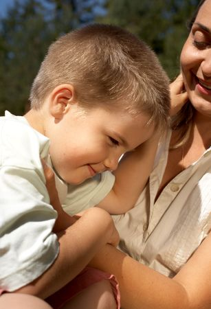 portrait of lovely boy in mother's hands Stock Photo - 511024