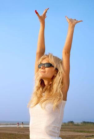 lovely blond raising hands to the sun Stock Photo - 521761