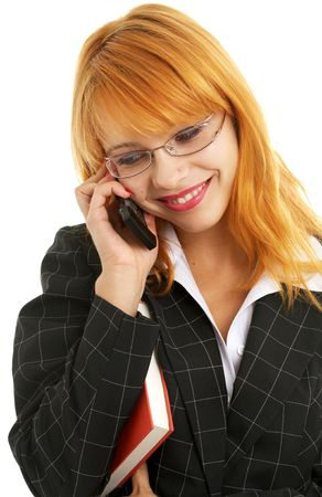 businesswoman with book making a phone call photo