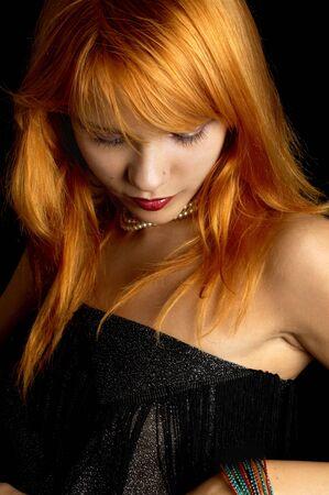 dark portrait of lovely redhead photo
