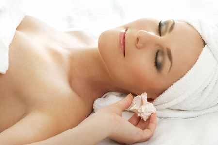 beautiful lady with sea shell in spa Stock Photo - 530805